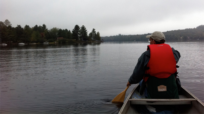 Camper Jim paddling on Raquette Lake New York